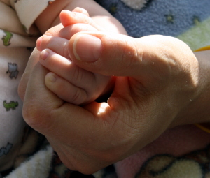 mom and daughter holding hands image